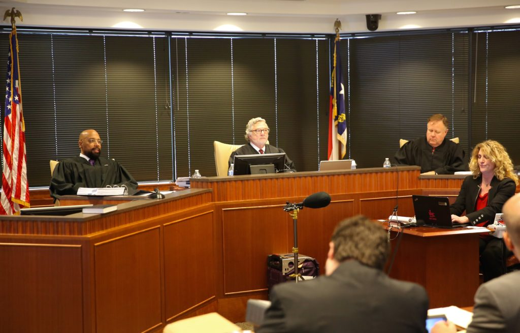 From left, Superior Court judges Todd Burke, Jesse Caldwell, and Jeffery Foster hear arguments in March in a lawsuit filed by Gov. Roy Cooper arguing that legislation passed during a December special session violates the separation of powers. (CJ photo by Don Carrington)