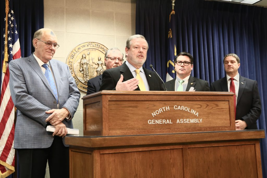 Senate leader Phil Berger, at lectern, announces a $1 billion tax cut at a March 16 press conference. With him are, from left, Sens. Jerry Tillman, Tommy Tucker, Andrew Brock, and Warren Daniel. (CJ photo by Don Carrington)