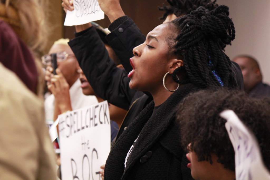 UNC students protested at a 2016 meeting of the Board of Governors, inciting controversy over unlawful speech practices. (CJ Photo by Kari Travis)