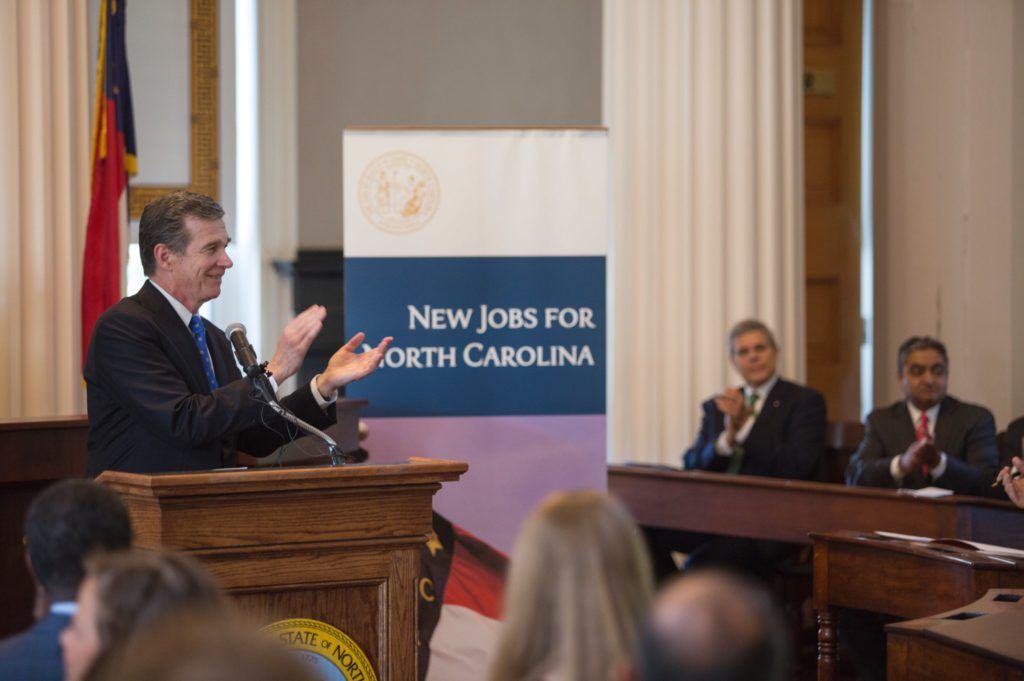 Gov. Roy Cooper announces targeted incentives for Infosys during a July 6, 2017, news conference. Photo taken from @NC_Governor Twitter account.