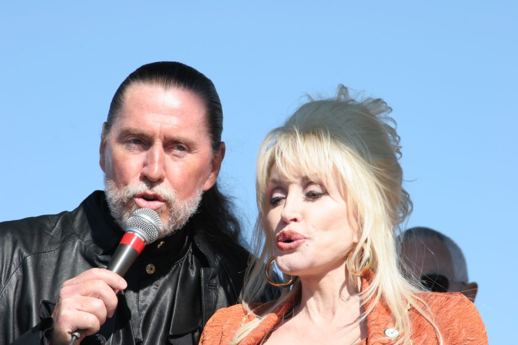 Randy and Dolly Parton offer an impromptu performance at the November 2005 groundbreaking for the theater that would bear Randy's name. (CJ photo by Don Carrington)