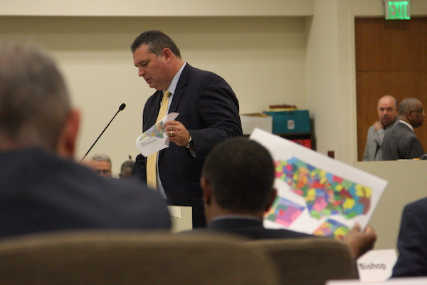 Rep. David Lewis, R-Harnett, the chairman of the House redistricting committee, discusses electoral maps during a July 2017 organizational meeting of a joint legislative redistricting committee he co-chairs. (Photo by Dan Way).