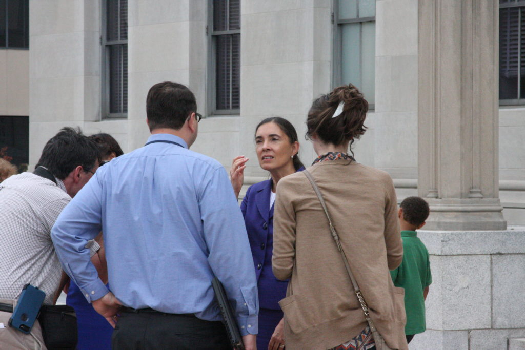 N.C. Supreme Court Justice-elect Anita Earls, then an attorney for the Southern Coalition for Social Justice, spoke with reporters in July 2017 outside the U.S. courthouse in Greensboro. (CJ photo by Dan Way)