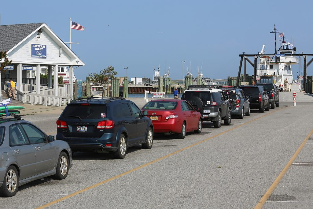 Travelers in late July line up for the next ferry from Hatteras to Ocracoke. DOT thinks some will leave their cars in Hatteras and take a new passenger ferry. (CJ photo by Don Carrington)