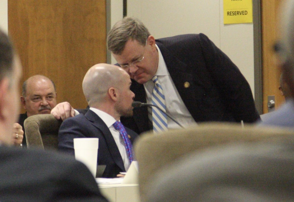 House Speaker Tim Moore, R-Cleveland, confers with Rep. Justin Burr, R-Stanly (seated), at Thursday's meeting of the Joint Select Committee on Judicial Reform and Redistricting. (CJ photo by Dan Way)