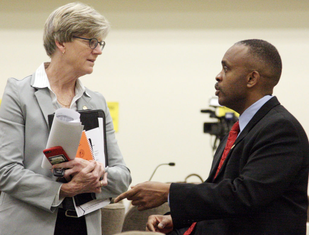 State Rep. Marcia Morey, D-Durham, talks with Rep. Robert Reives, D-Lee, prior to the start of a meeting Friday, April 27, of the Joint Select Committee on Judicial Reform and Redistricting. (CJ photo by Dan Way)