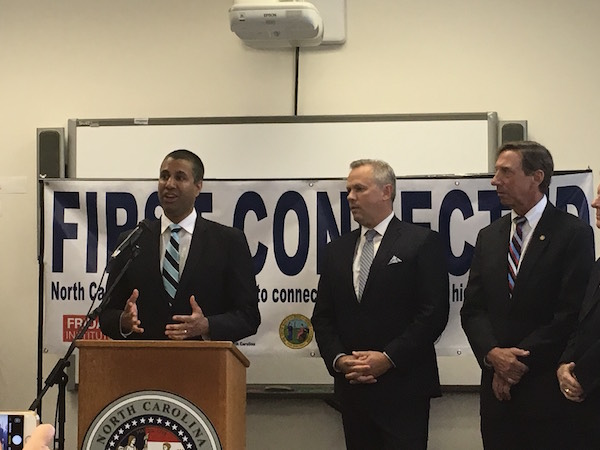 FCC Chair Ajit Pai, joined by Lt. Gov. Dan Forest and Sen. Rick Gunn, R-Alamance, talks about the future of digital learning at Graham High School. (CJ Photo by Lindsay Marchello)