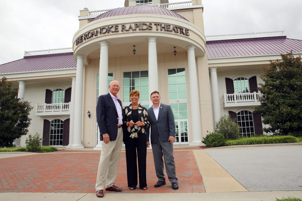 Evon McLean, center, holds the keys to the Roanoke Rapids Theatre. She and her husband Tom, left, purchased the facility July 23. Her son Beau Petty, right, will play a key role in managing the facility. (CJ photo by Don Carrington)