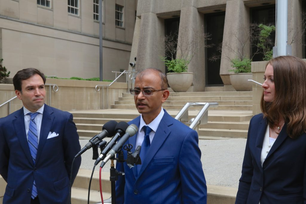 At a July 31, 2018, press conference, Dr. Gajendra Singh, a Forsyth County surgeon, discusses the lawsuit he has filed challenging certificate of need laws. At left is Raleigh attorney H. Denton Worrell and at right is Institute for Justice Attorney Renee Flaherty. (CJ photo by Don Carrington)