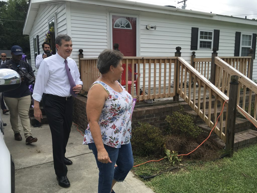 Brenda Jacobs, a Lumberton resident, shows Gov. Roy Cooper the repairs done to her house nearly two years after Hurricane Matthew tore through the area. (CJ photo by Lindsay Marchello)
