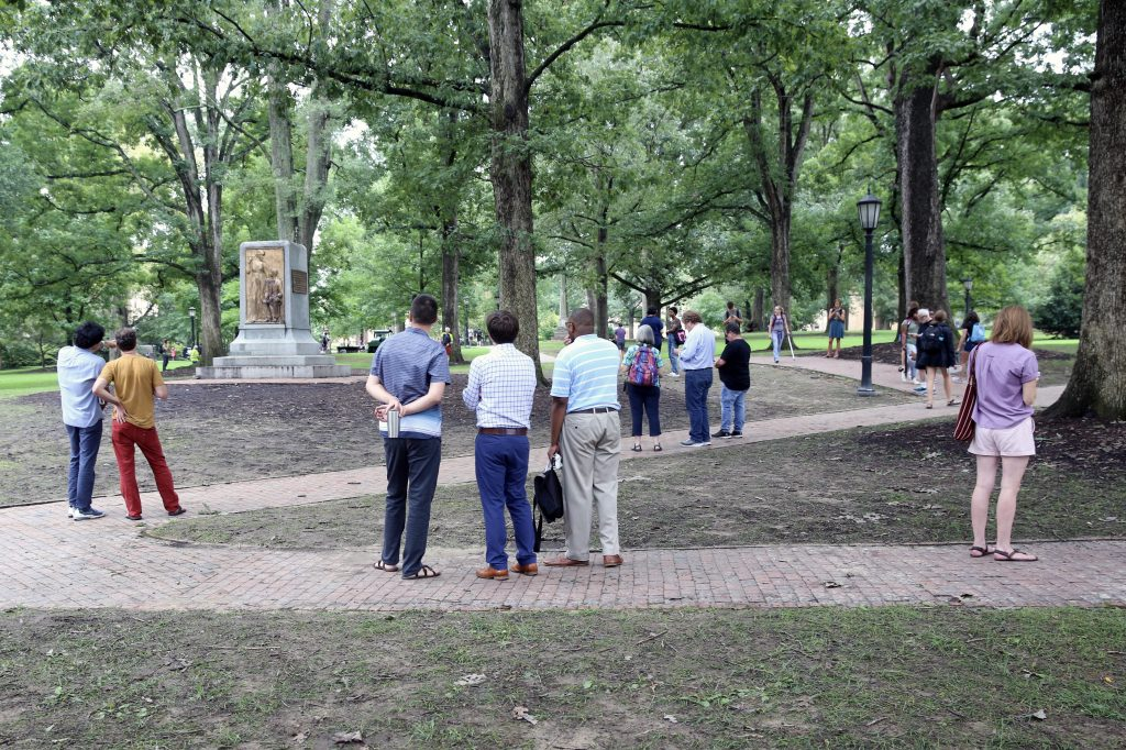 "Onlookers view the base of ""Silent Sam"" Tuesday, Aug. 20, the day after protesters removed the Confederate monument from its post at UNC-Chapel Hill. (CJ photo by Don Carrington)"