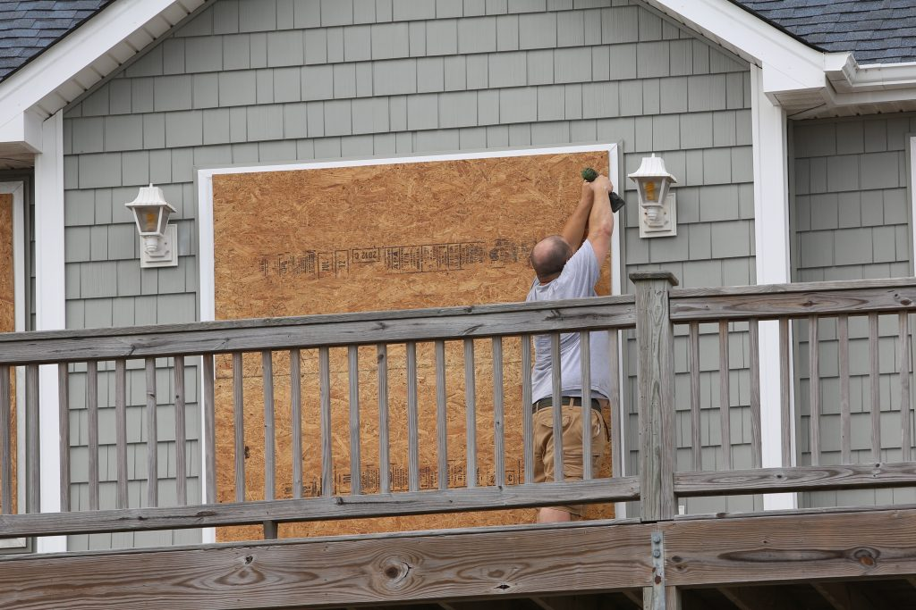 A resident of Topsail Beach protects his home. (CJ photo by Don Carrington)
