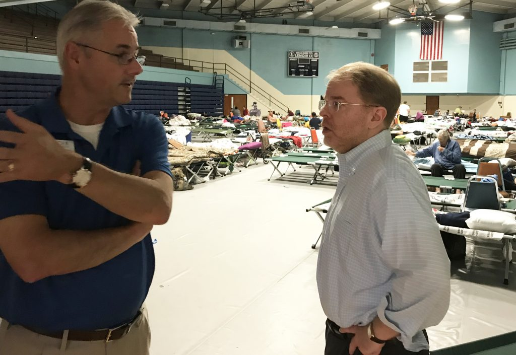 Peter Hans (right) visits a community shelter at Lenoir Community College in Kinston Sept. 18. At the peak of Hurricane Florence 500 displaced residents were sheltered on the campus. (Photo courtesy of Peter Hans)
