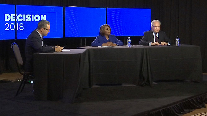 From left, Spectrum News' Tim Boyum moderated a debate Oct. 22 between 2nd Congressional District candidate Linda Coleman, a Democrat, and incumbent Republican Rep. George Holding. (Photo from Spectrum News)
