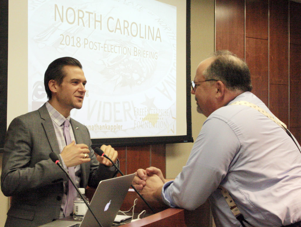 Jonathan Kappler (left), executive director of the N.C. FreeEnterprise Foundation, chats with his predecessor Joe Stewart at a Nov. 7 post-election briefing in Raleigh. (CJ photo by Dan Way)