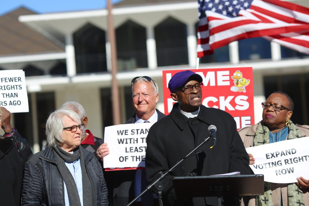 The Rev. Dr. Anthony Spearman, president of the N.C. NAACP, speaks at a Nov. 27 Moral Day of Protest rally in Raleigh. At left is the Rev. Nancy Petty of Pullen Memorial Baptist Church. (CJ photo by Don Carrington)