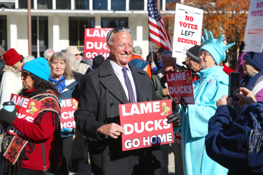Mark Jewell, president of the N.C. Association of Educators, joins protesters at a Nov. 27 rally opposing voter ID. (CJ photo by Don Carrington)