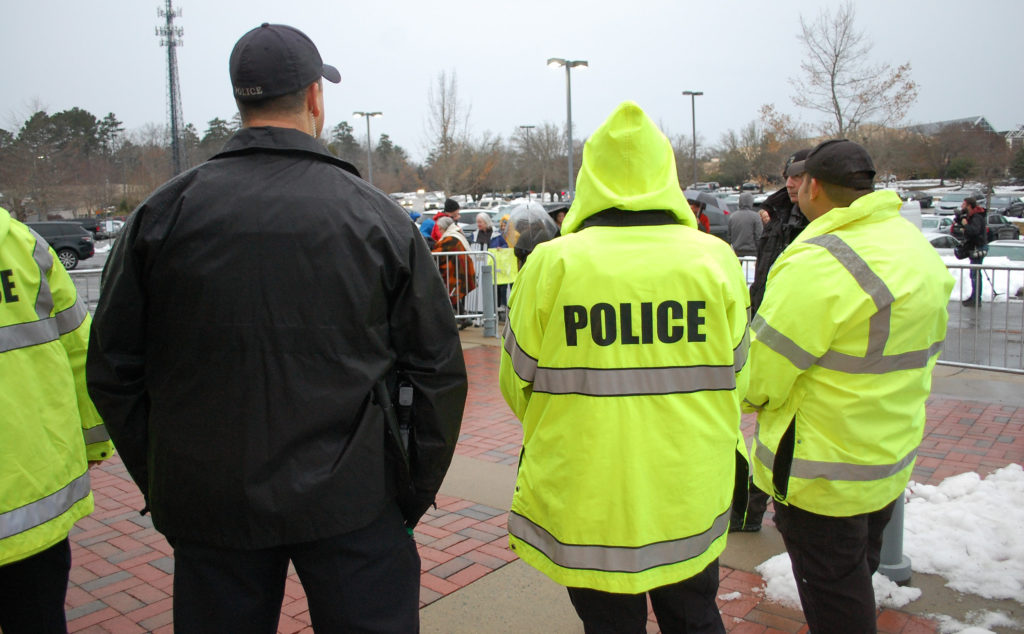Over 100 police officers gathered at UNC's Center for School Leadership Development Dec. 14 to keep protests from getting out of hand. Rain ultimately kept large crowds away. (Carolina Journal photo by Kari Travis)