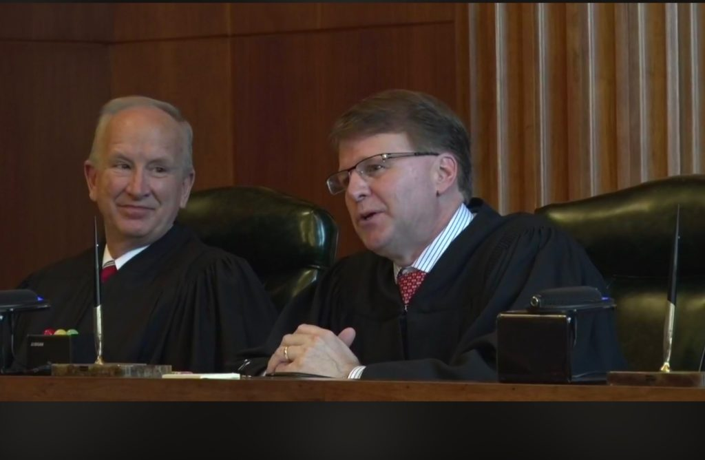 N.C. Supreme Court Chief Justice Mark Martin, right, delivers remarks during the Jan. 7, 2019, celebration of the court's 200th anniversary. Senior Associate Justice Paul Newby listens.