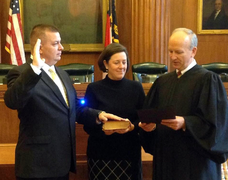 Phil Berger Jr., with his wife Jodie beside him, takes the oath of office for the N.C. Court of Appeals in January 2017 from Supreme Court Associate  Justice Paul Newby. (Image from Phil Berger Jr.'s Facebook page)