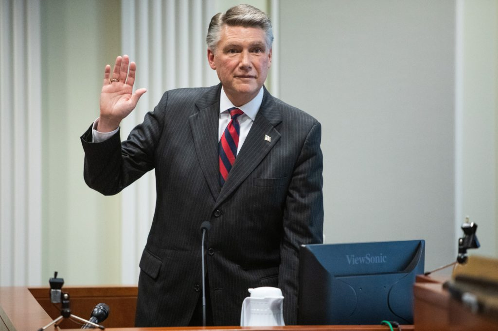 Mark Harris, Republican candidate in North Carolina's 9th Congressional race, prepares to testify during the fourth day of a public evidentiary hearing on the 9th Congressional District voting irregularities investigation Thursday, Feb. 21, 2019, at the North Carolina State Bar in Raleigh. (News & Observer pool photo)