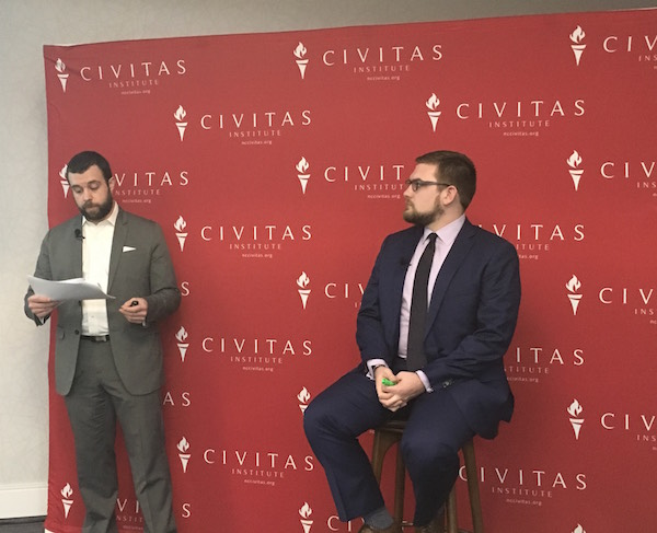 Civitas Institute President Donald Bryson (left) and WBTV investigative reporter Nick Ochsner (right) discuss the results of the March Civitas Poll during a March 27 luncheon. (CJ photo by Lindsay Marchello)