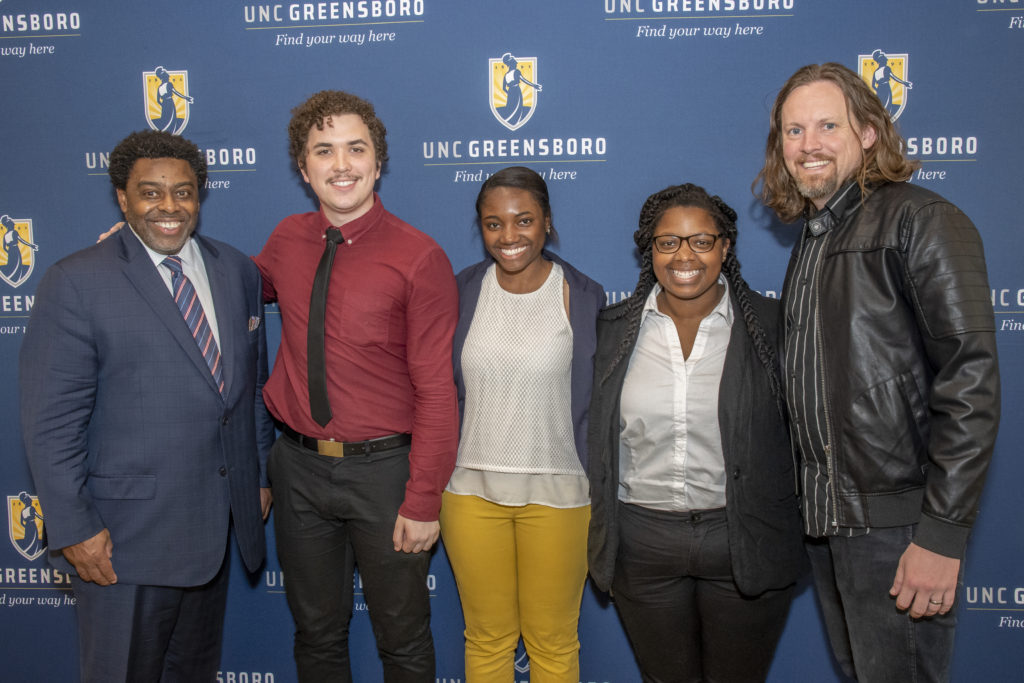Filmmaker Adam Fenderson (right) at an afternoon reception and panel discussion with UNCG students Margaree Brown, (center right), Mckayla Bohannon, (center), and Nicholas Smurthwaite, (center left). UNCG Chancellor Franklin Gilliam (left) also presented at the panel. (Photo courtesy of UNCG)