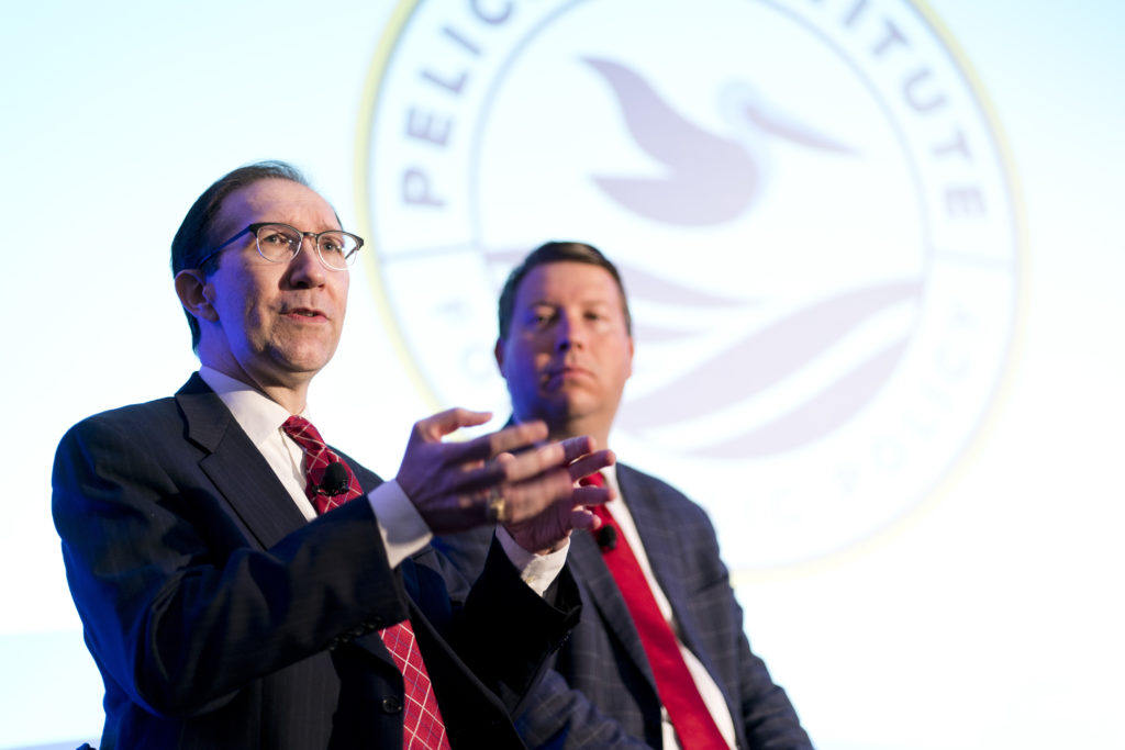 Mitch Kokai of the John Locke Foundation discusses recent N.C. tax reforms as Jonathan Williams of the American Legislative Exchange Council listens. Both men addressed the Pelican Institute's March 28, 2019, policy summit. Photo courtesy of Jason Cohen Photography.
