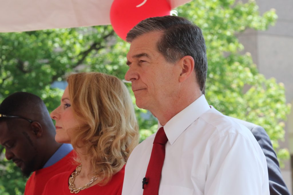 Gov. Roy Cooper, with First Lady Kristen Cooper at his side, helped rally teachers at the May 1, 2019, march on Raleigh. (CJ photo by Don Carrington)