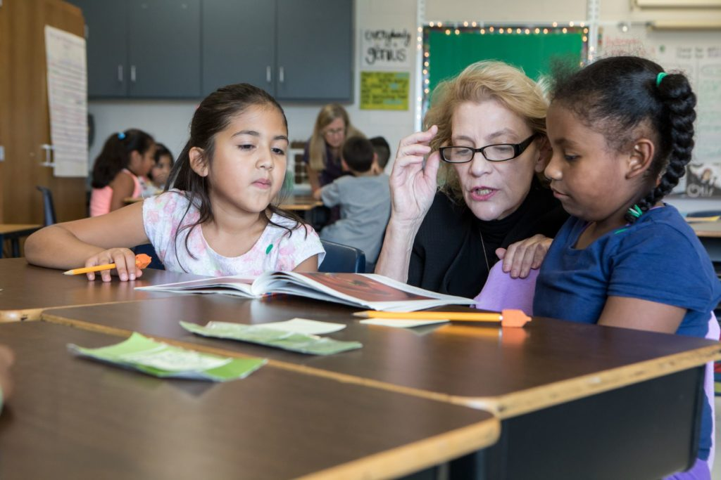 Appalachian State University Chancellor Shari Everts reads to students during a visit to Middle Fork Academy. (Photo courtesy of Marie Freeman, Appalachian State University)