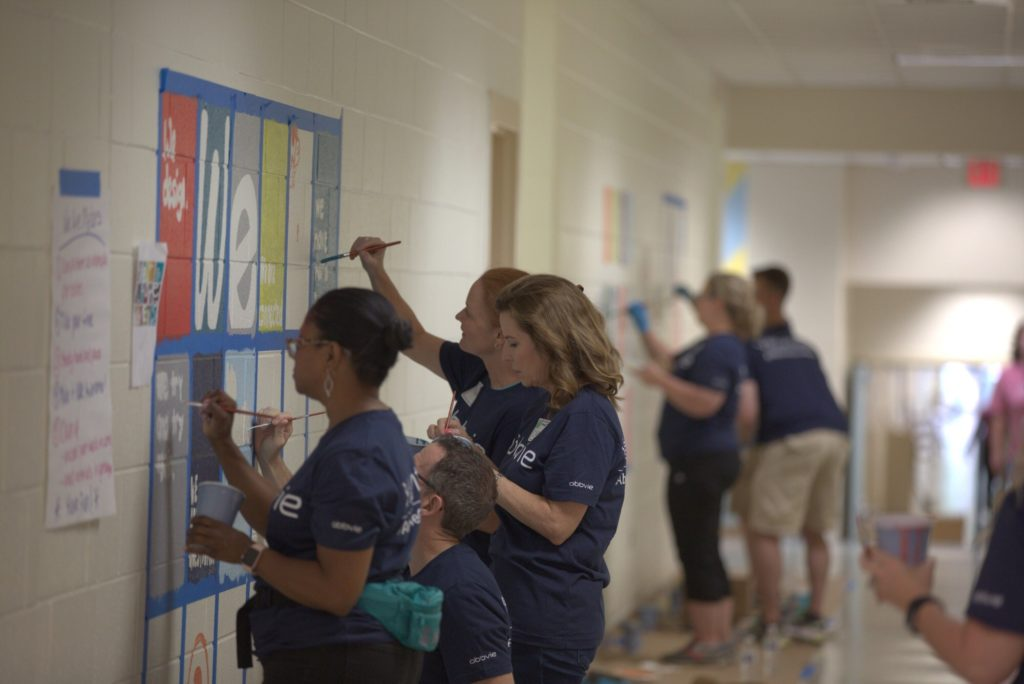 AbbVie volunteers work on a mural at Creech Road Elementary as part of the company's sixth annual Week of Possibilities. (Photo courtesy of Creech Road Elementary)