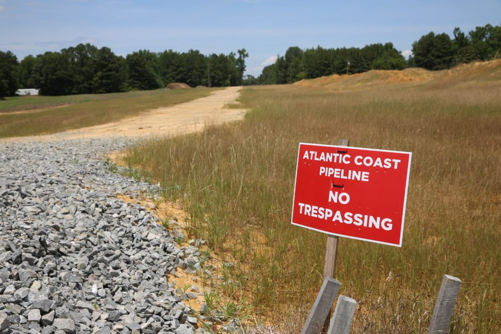 Atlantic Coast Pipeline contractors have installed 12 miles of pipeline in Northampton County, including this section beside the sign. (CJ photo by Don Carrington)