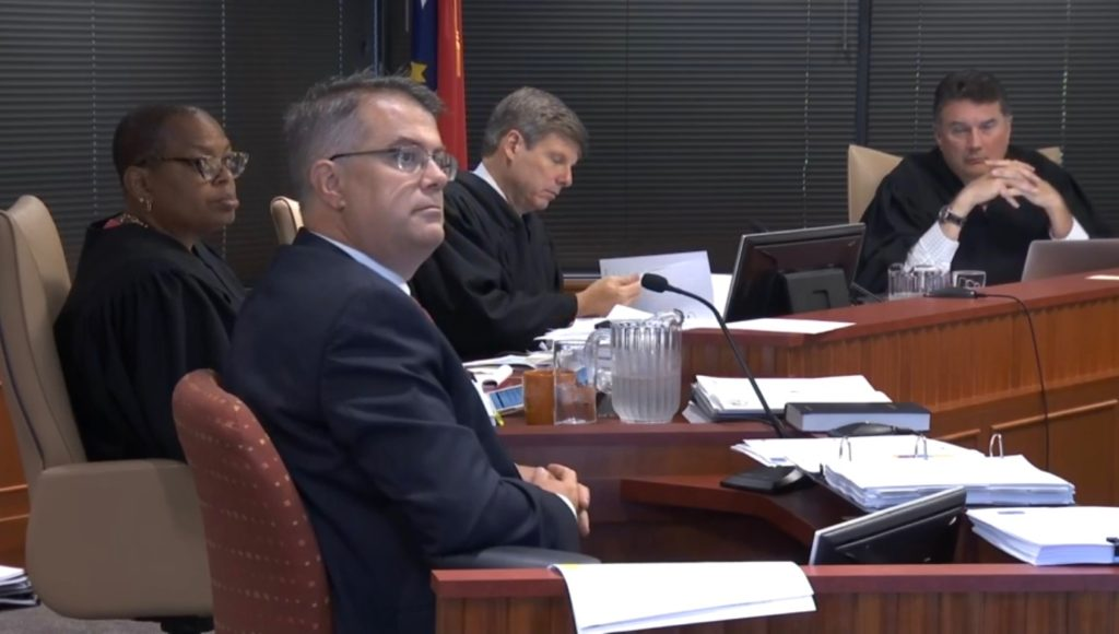 Defendants' witness Douglas Johnson testifies July 25, 2019, during the Common Cause v. Lewis partisan gerrymandering trial. (WRAL.com screen shot)
