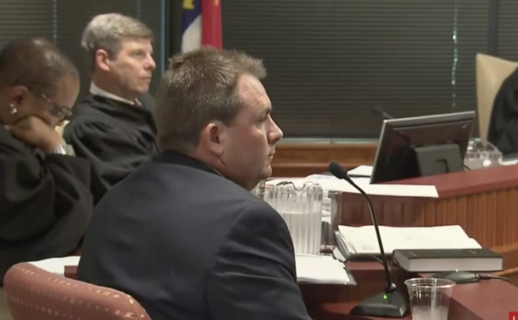 House Majority Leader John Bell, R-Wayne, testifying July 25 in the Common Cause v. Lewis trial. (Screenshot from WRAL pool video feed)