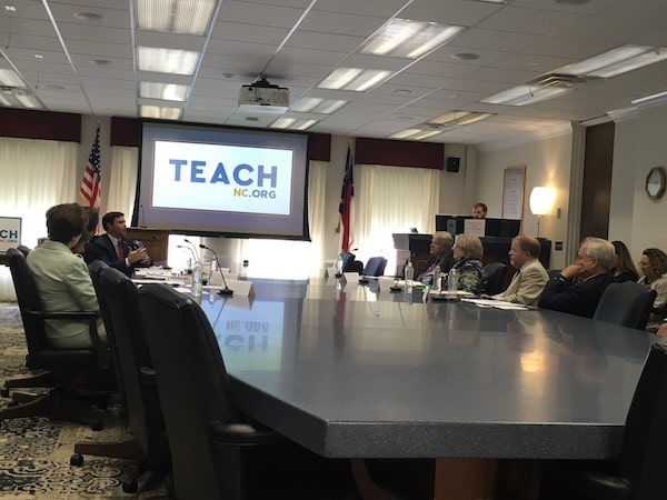Members of the Education Cabinet listen as State Superintendent Mark Johnson explains how TeachNC will draw more people to teaching. (CJ photo by Lindsay Marchello)