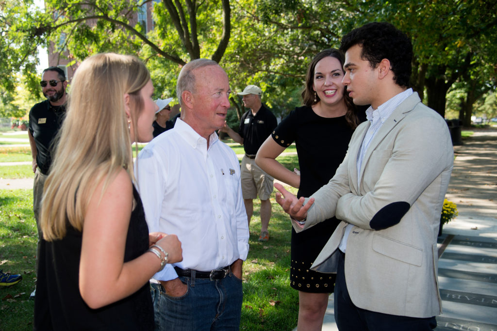 Mitch Daniels, 12th president of Purdue University, speaks with students on the West Lafayette, Indiana, campus in February 2019. (Purdue University Marketing and Media / Mark Simons)