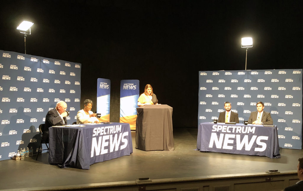 Participants in the Hometown Debate on health care costs Oct. 2 in Salisbury, sponsored by the N.C. Institute of Political Leadership. From left, former Rep. Bill Brawley, R-Mecklenburg, Rep. Carla Cunningham, D-Mecklenburg, Spectrum News anchor and host Loretta Boniti, Brendan Riley of the N.C. Justice Center, and Jordan Roberts of the John Locke Foundation. (CJ photo by Branson Inscore)