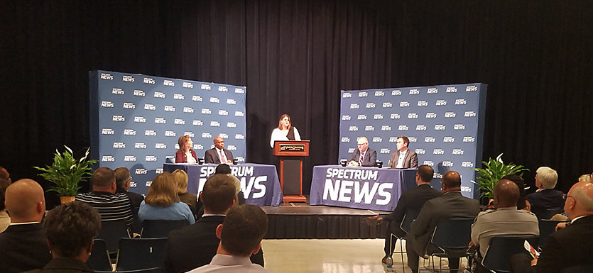 Panelists at the final 2019 N.C. IOPL Hometown Debate Thursday, Oct. 17, in Henderson were, from left, Rep. Donna White, R-Johnston; Rep. Terry Garrison, D-Vance; moderator Loretta Boniti of Spectrum News; Greg Griggs of the Academy of Family Physicians; and Jordan Roberts, health care policy analyst at the John Locke Foundation. (Screenshot from Spectrum News)