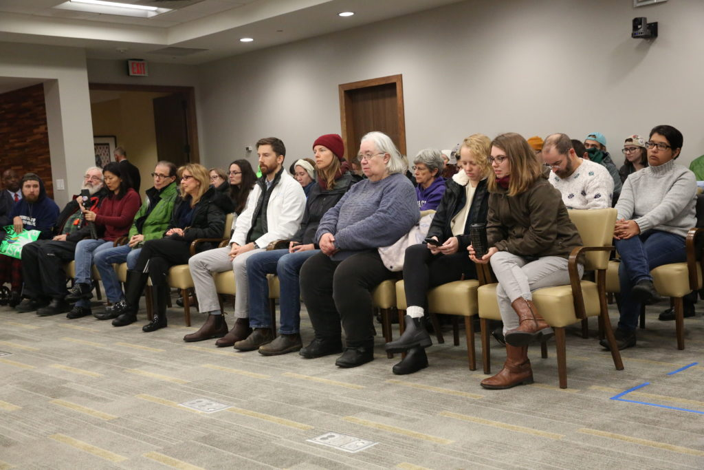 Protesters at the Dec. 13, 2019, UNC Board of Governors meeting in Chapel Hill sat quietly before walking out as the board went into closed session. (CJ photo by Don Carrington)