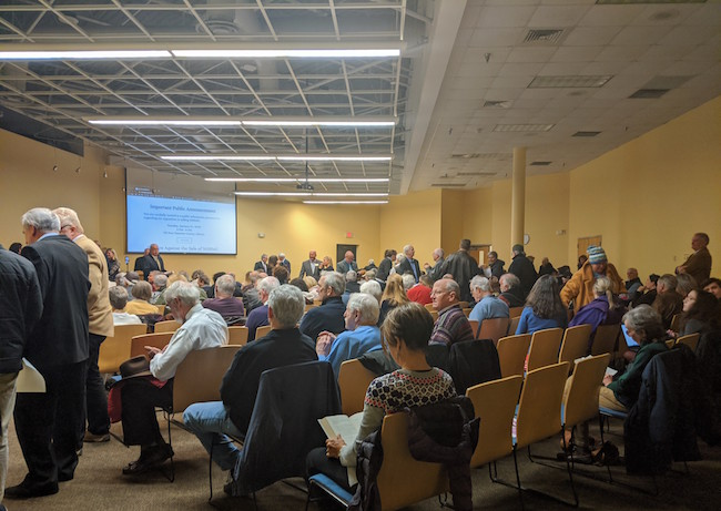 As New Hanover County considers selling or partnering its hospital, some 200 people attended the Save Our Hospital meeting to protest the process on Tuesday, Jan. 21. (CJ photo by Julie Havlak)