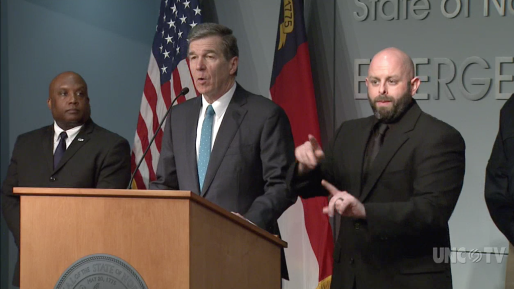 Gov. Roy Cooper announced an end to sit-down dining at restaurants and private clubs in a March 17, 2020 news conference. (Screenshot from UNC-TV)