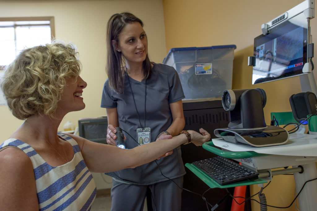 Dr. Carrie Castille is examined by a new telemedicine device used to examine patients while instantly transmitting the physical assessment back to an off-site nurse practitioner. (USDA Photo by Preston Keres)