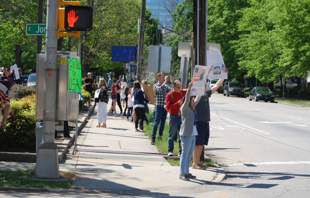 ReopenNC members protest across from the Legislative Building in Raleigh April 14. (CJ photo by Rick Henderson)