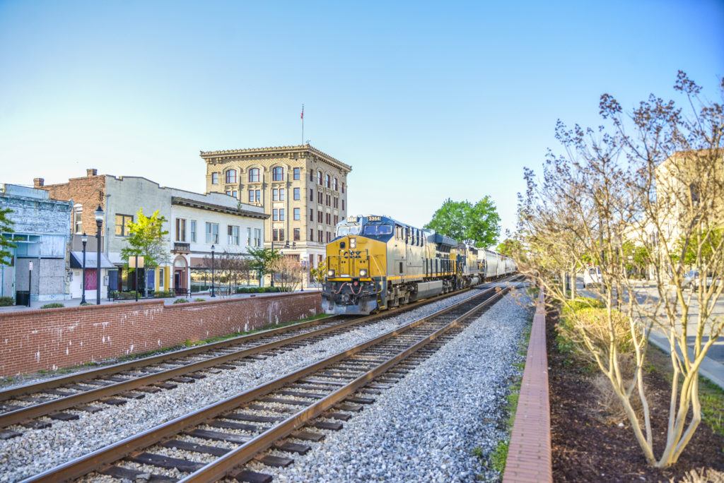 A CSX train passes through downtown Rocky Mount. (Public domain image from Wikipedia)