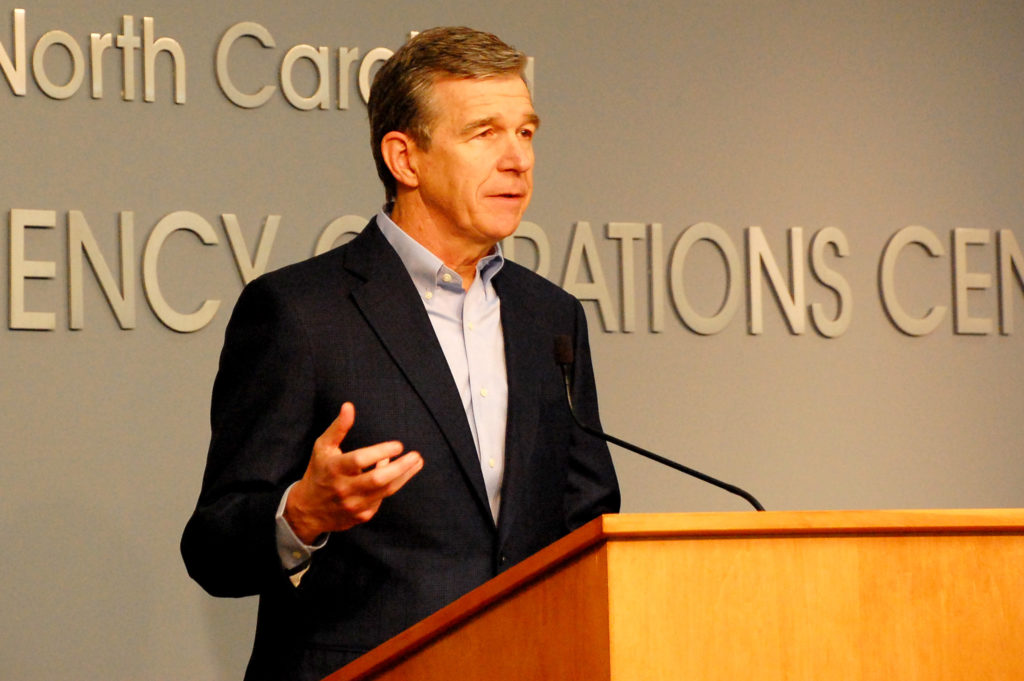 Gov. Roy Cooper addresses a news briefing about riots in several N.C. cities May 31, 2020. (Pool photo)