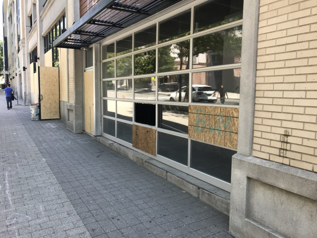 Boarded-over storefront on Fayetteville Street in Raleigh after riots in late May. (CJ photo by Rick Henderson)