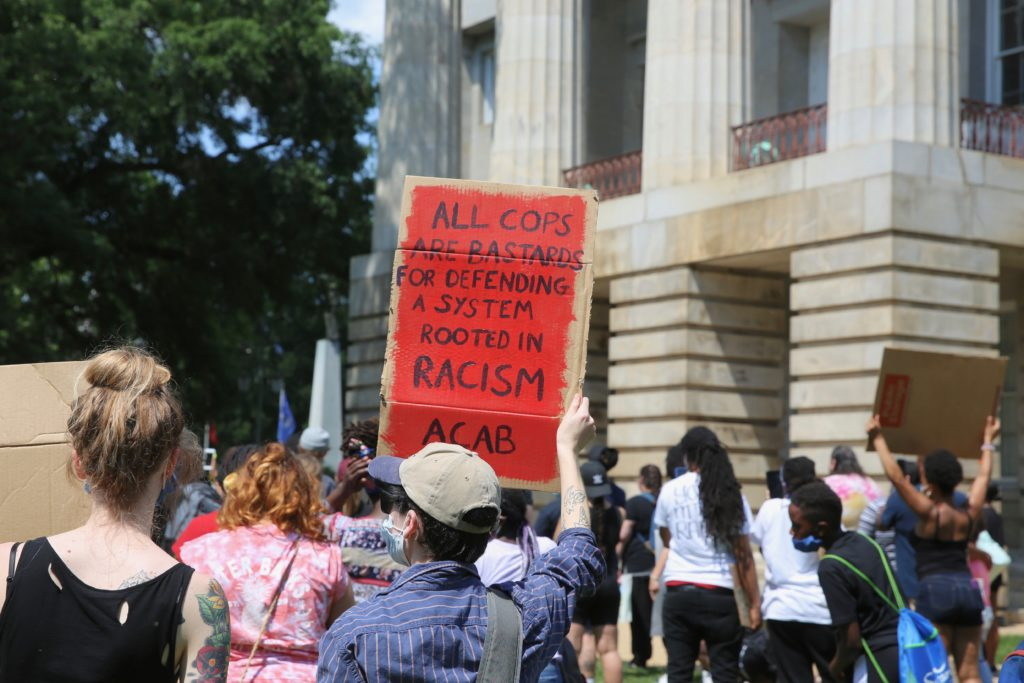 Protesters during an early June rally in Raleigh. (CJ photo by Don Carrington)