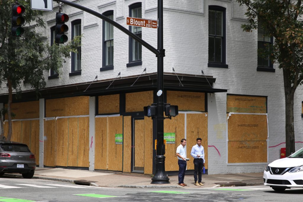 Shops in downtown Raleigh remain boarded up in late June, weeks after rioters trashed restaurants and retailers. (CJ photo by Don Carrington)