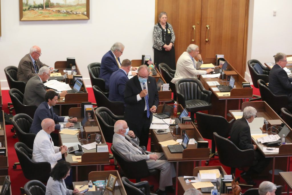 Rep. Chuck McGrady, R-Henderson, speaks on the state House floor in late June. (CJ photo by Don Carrington)