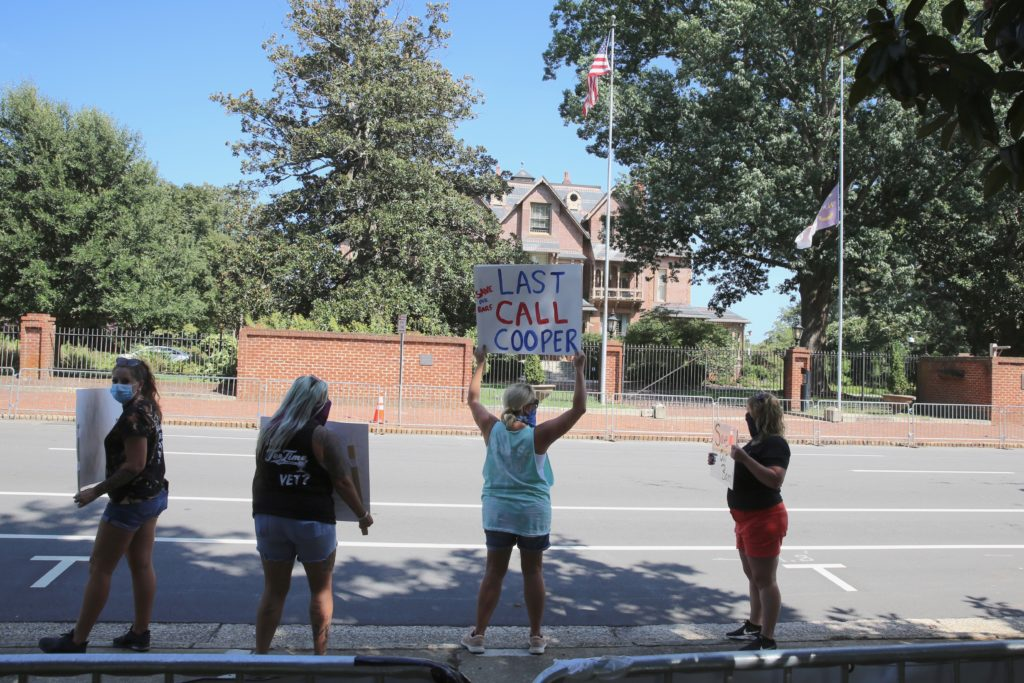Protesters outside the Executive Mansion urge Gov. Roy Cooper to ease his COVID-19 order closing private bars. (CJ photo by Don Carrington)